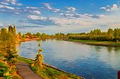 image of impressionist  - Impressionistic view of a river under blue cloudy sky - JPG