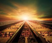 foto of train track  - junction of railways track in trains station agains beautiful light of sun set sky use for land transport and logistic industry background backdropcopy space theme - JPG