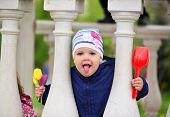 picture of taint  - Two year old girl looks out from the gazebo - JPG