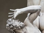 stock photo of rape  - detail of an old man in Rape of Sabine women statue in Florence Italy - JPG