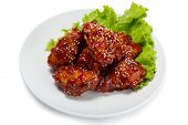 image of korean  - Chunks of chicken in a spicy sauce and sesame seeds - JPG