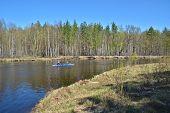 stock photo of kayak  - Kayak tourists on spring river - JPG