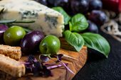 foto of cheese platter  - Food backgroundrustic board with cheese herbs and grapes - JPG