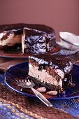 pic of icing  - Delicious chocolate cake with icing in plate on table - JPG