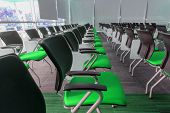 image of training room  - Many green chairs arranged neatly in a training room - JPG