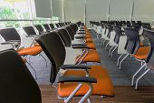 picture of training room  - Many dark yellow chairs arranged neatly in a training room - JPG