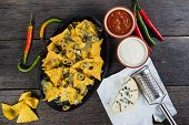 stock photo of nachos  - traditional nachos with cheese and salsa from above - JPG