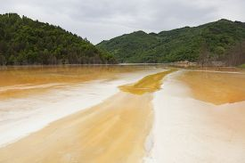 picture of polution  - POluted lake in the mountains from a mine in romania - JPG
