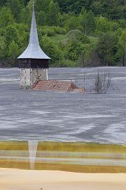 foto of polution  - Flooded church in poluted mud lake in transilvania - JPG