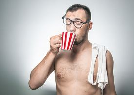 foto of nerds  - Close up tired sleep man holding coffee cup stay awake isolated on gray background - JPG