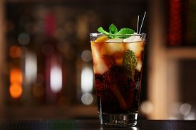picture of coca-cola  - Glass of cocktail in bar on bright blurred background - JPG