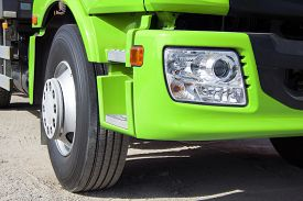 stock photo of trucks  - Trailer truck DSLR photography truck heavy freight transportation of large cargoes modern truck truck cab bright paint horizontal image the wheel of the truck the optical lamp on the truck. ** Note: Shallow depth of field - JPG
