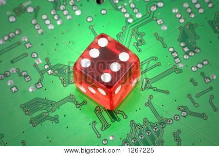 Picture or Photo of Red dices and circuit board concept of online gambling