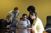 stock photo of business meetings  - group of young people discussing a project during a meeting - JPG