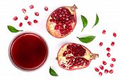 A Glass Of Pomegranate Juice With Fresh Pomegranate Fruits Isolated On White Background. Top View. F poster