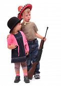 stock photo of sherif  - Boy and girl dressed in retro costume from American Old West - JPG