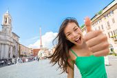 Rome tourist woman thumbs up happy on Piazza Navona. Young Asian girl on Europe vacation travel smil poster