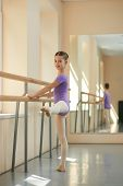 Beautiful Young Ballerina In Ballet Studio. Cute Young Girl Training Near Barre In Ballet Hall. Ball poster