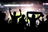Friends At Football Game In Soccer Stadium. Crowd Cheering And Celebrating A Goal In Arena During Ma poster