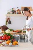Cooking woman in kitchen with wooden spoon. Cooking woman poster