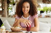 Atttractive Restful African American Female With Bushy Curly Hair, Enjoys Summer Holidays Or Break A poster
