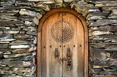 Old Wooden Door In The Stone Wall From Medieval Era poster