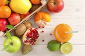Juice And Fruits On Background Top View. Healthy Lifestyle. A Glass Of Freshly Squeezed Juice On The poster