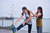Sports Concept. Beautiful Girl Is Exercising On The Beach With Warm Up. Beautiful Girl Is Happy To E poster