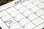 April 15th Is The Tax Day In The United States. As A Reminder, Calendar Sitting On Top Of 1040 Tax F poster