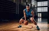 Full Body Portrait Of Black Professional Basketball Player In An Action In Basketball Field. poster