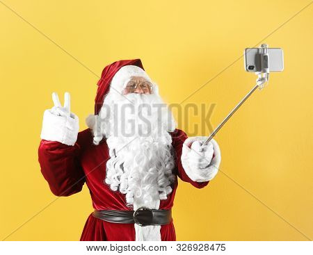 poster of Authentic Santa Claus Taking Selfie On Yellow Background