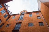 Copenhagen, Denmark - May 04, 2019: Courtyard Of An Old Orange House In Copenhagen, Denmark poster