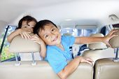 picture of road trip  - Asian children ready for a road trip posing in car - JPG