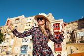 Happy Young Carefree Woman Enjoying Sightseeing In Valletta, Malta, Europe poster