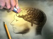Someone is erasing a drawing of the human brain. Conceptual image relating to dementia and memory lo