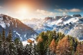 Wooden House In Winter Mountains At Sunset. Ski Resort In Dolomite Alps. Val Di Fassa, Italy. Beauti poster