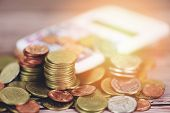 Save Money Coins On Table / Pile Of Golden Coin, Silver Coin And Copper Coin With Calculator Money F poster