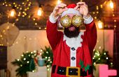 Bearded Man Santa Claus Decorating Christmas Tree With Golden Decorations. Most Wonderful Time Of Ye poster