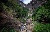 The Ravana Waterfalls Is A Popular Sightseeing Attraction In Sri Lanka poster