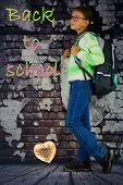 Light Heart  And Little Girl With Schoolbag On Her Back Standing Near Old Brick Wall With Back To Sc poster