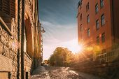 Stockholm, Sweden. Sunshine During Sunset Above Stockholm Street. Beautiful Street With Multi-storey poster