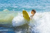 image of papagayo  - boy has fun surfing in the waves - JPG