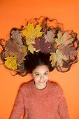 Leafy Hairstyle. Small Girl Wear Autumn Foliage In Curly Hairstyle. Best Autumn Hairstyle. Creating  poster