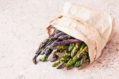 Bunch Of Fresh Purple Asparagus Spears Standing Vertical poster