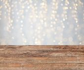 holidays concept - empty wooden surface or table with christmas golden lights background poster