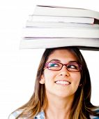 Geeky female student with books on her head - isolated over white