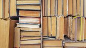 Many Sorted Old Books Are Stacked As A Background Front View. Stack Of Used Old Books In The School  poster