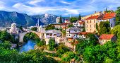 Amazing iconic old town Mostar with famous bridge in Bosnia and Herzegovina, popular tourist destina poster