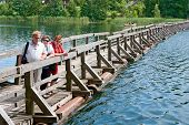 picture of pontoon boat  - Old pontoon bridge on Lake Galve in Trakai Lithuania - JPG
