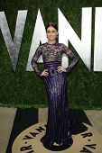 WEST HOLLYWOOD, CA - FEB 24: Lily Collins at the Vanity Fair Oscar Party at Sunset Tower on February